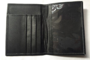 Open black passport holder image. close up.